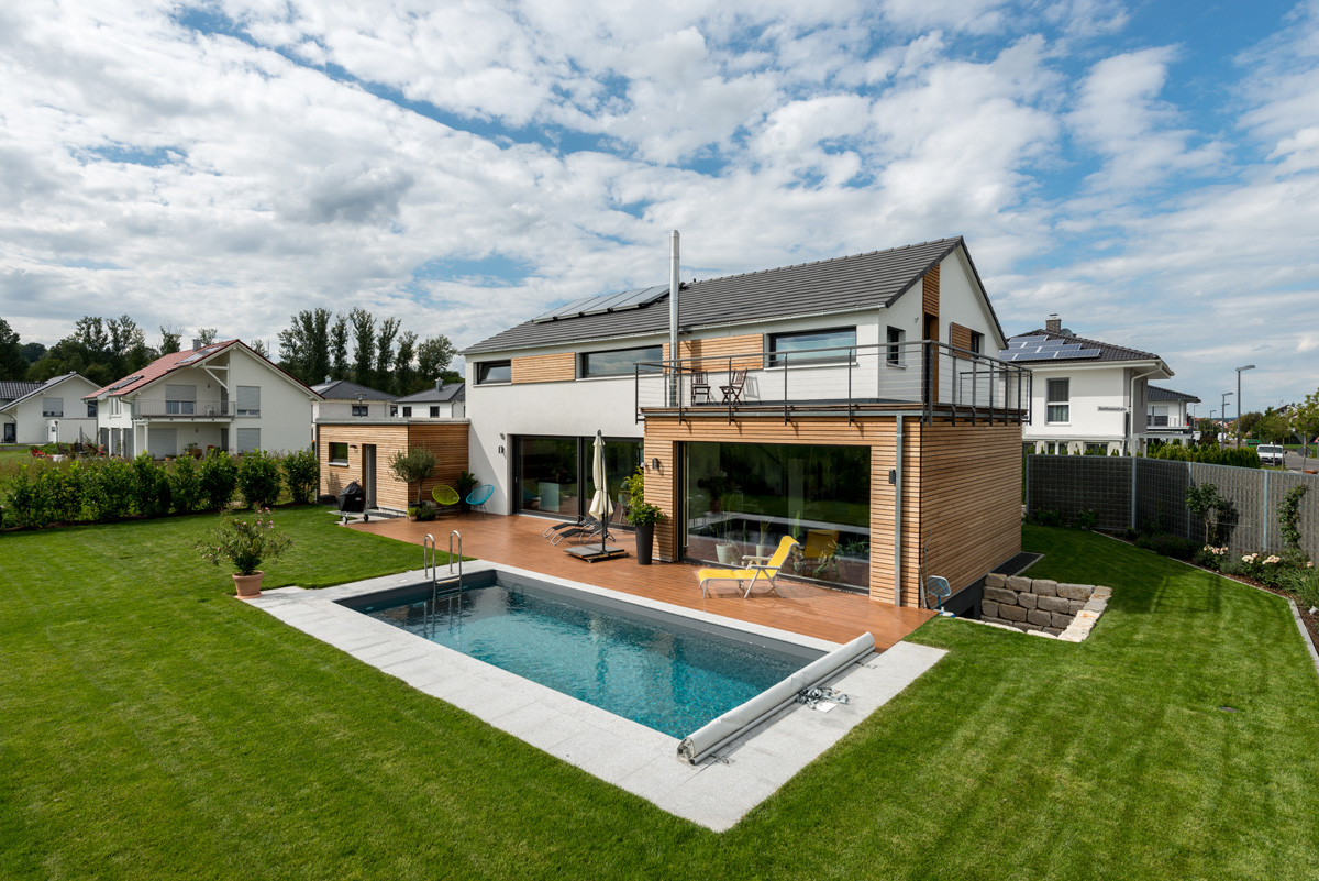 Fertigh user mit holz bauen plusenergiehaus for Haus bauen katalog